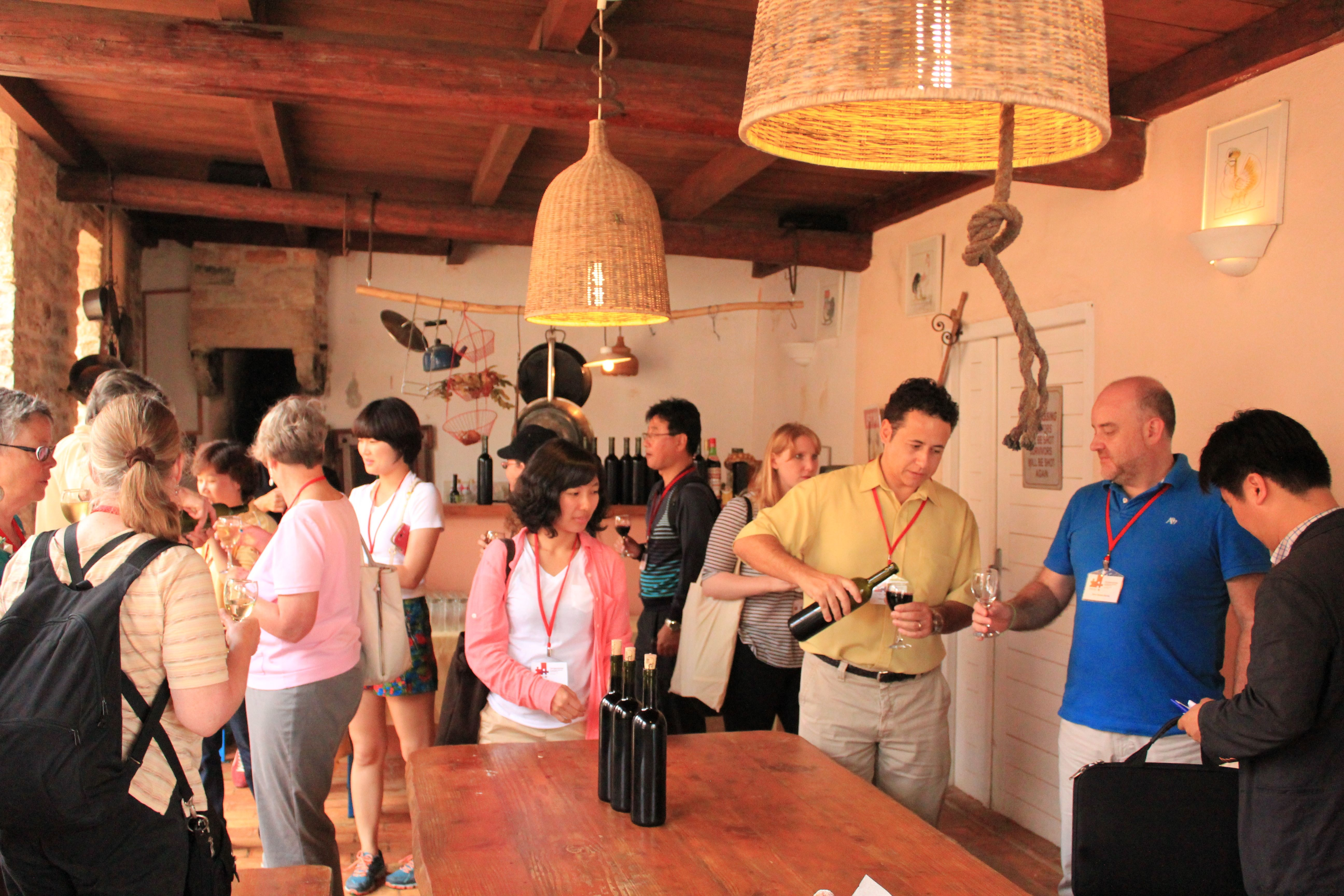 Members of the CCR and participants to its biennial global conference taste wine from a local co-operative in Pula, Croatia in 2014